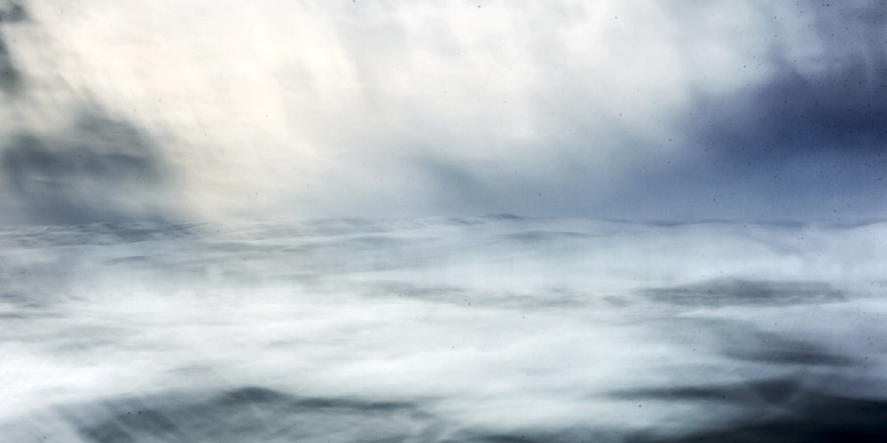 abstract fine art photography of the ocean taken from inside the water in Portugal on the atlantic coast