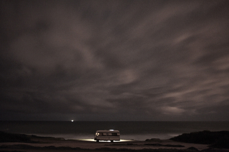 A van in the sea. my hymer van along the atlantic ocean