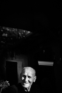 Fine art black and white photography of Tuscan lifestyle. An old man followed during the day in his activities