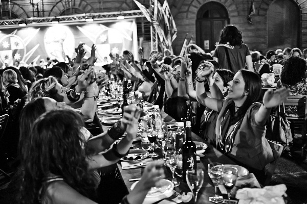 Fine art black and white photography of a dinner in Contrada della Pantera before the horse race , Palio di Siena 2014