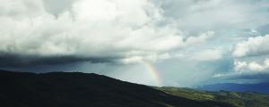 rainbow over tuscany hills