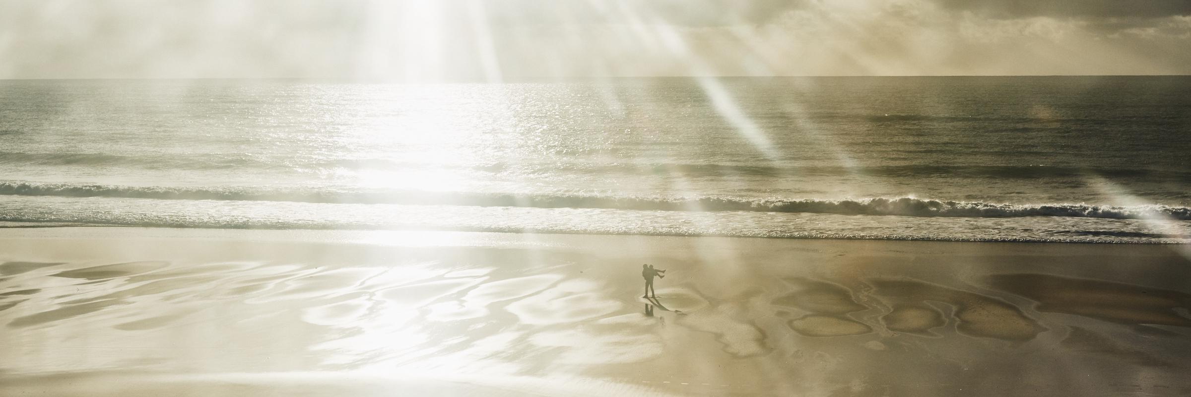 fine art seascape of a couple enjoying the beach in Alentejo