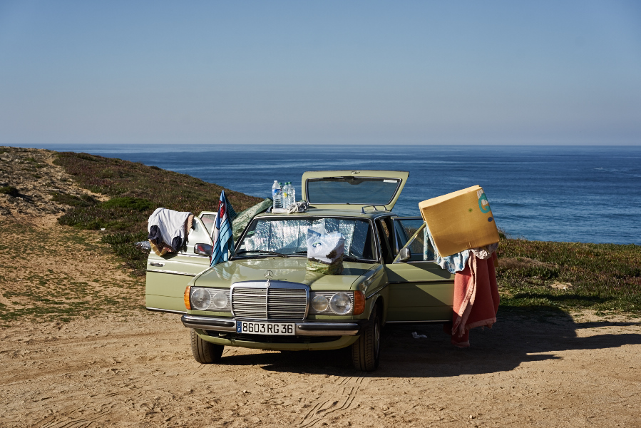 a car parked in alentejo along the coast, a fine art image of a car after someone slept there