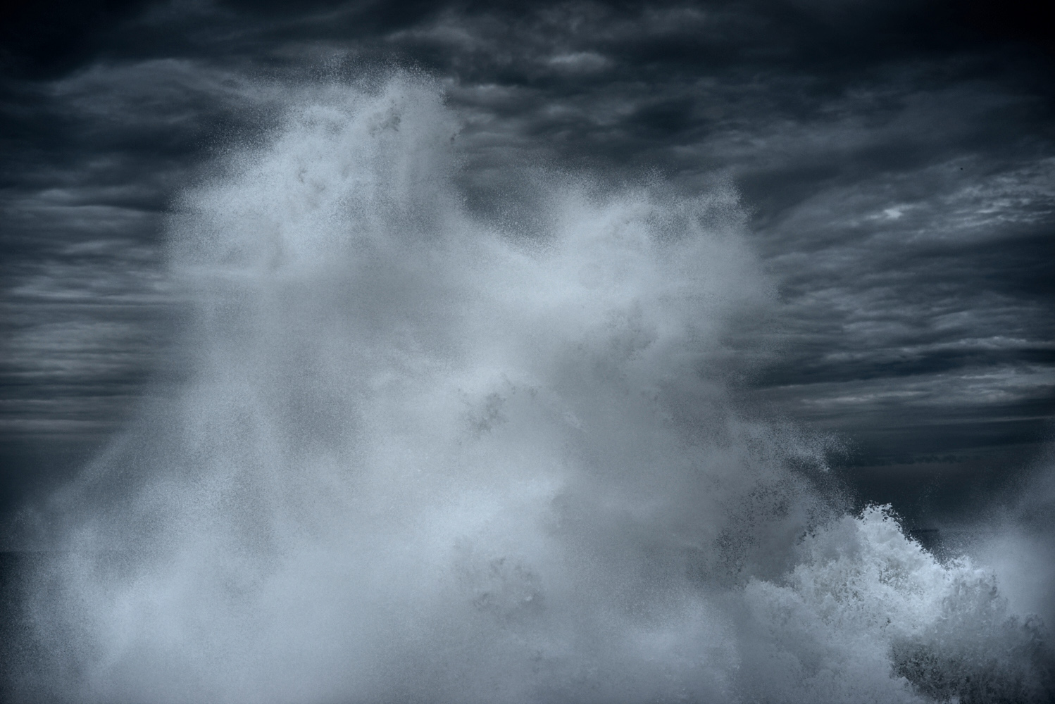 Abstract fine art image of a wave breaking on a rock on the Atlantic ocean