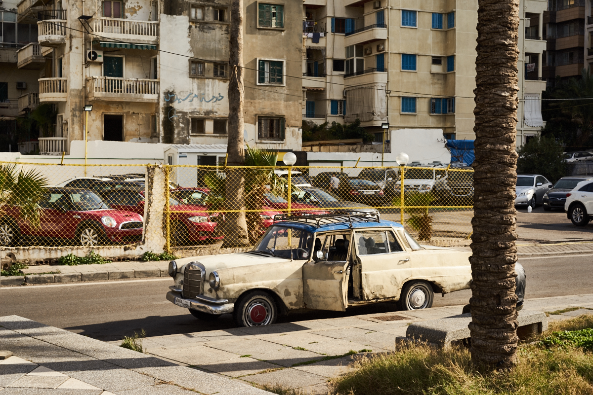 fine art image in Beirut of an old car next to new shinny ones