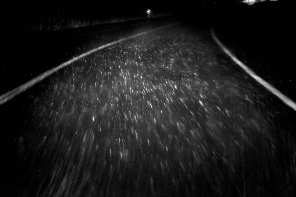 fine art black and white image of hard rain taken while driving a motorhome in Portugal on the way to Nazarè