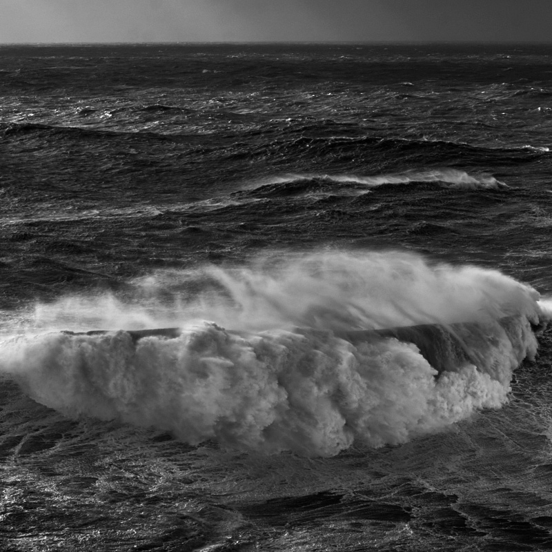 Fine art black and white landscape of a big wave breaking in Nzaarè