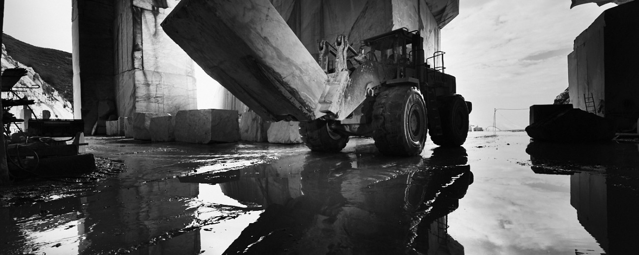 Black and white industrial corporate photography of a marble quarry in Carrara Italy