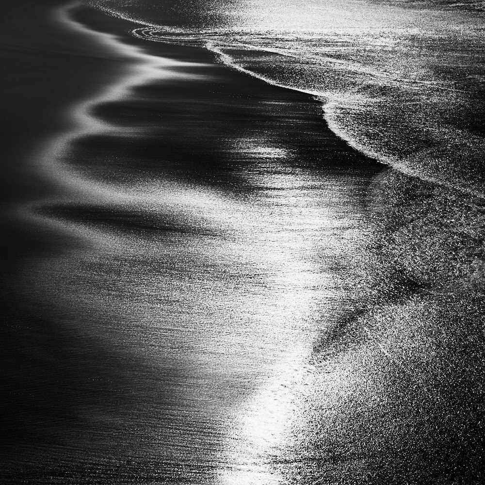 fine art black and white abstract photo of the Atlantic ocean in south Portugal.