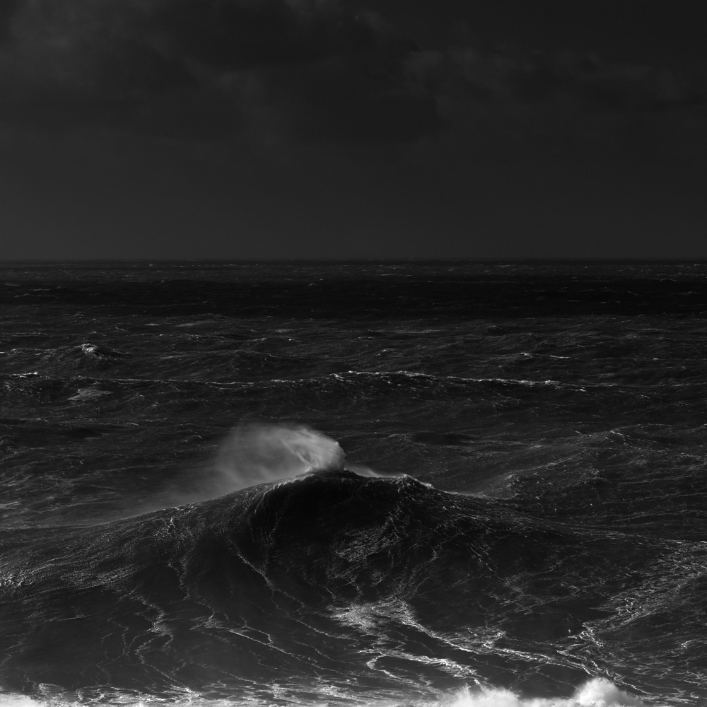 fine art black and white photo of the atlantic ocean during a big swell in Nazarè, Portugal