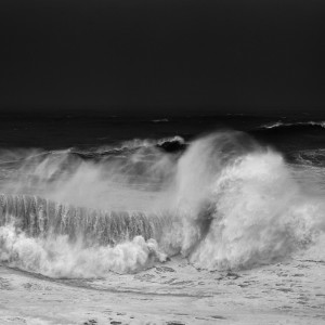 Fine art black and white landscape of a big wave breaking in Nzaarè