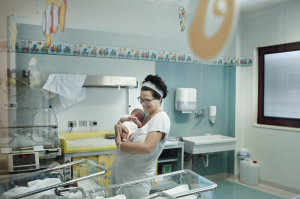 fine art and reportage photography of my sister at the hospital in the ocean town of Cecina