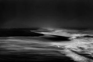 a fine art black and white photograph of the ocean on a foggy day