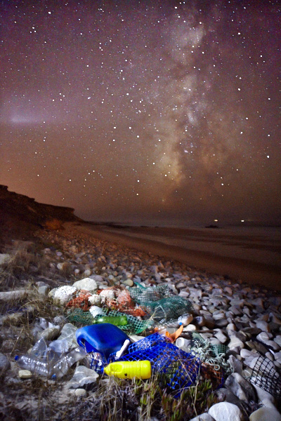 fine art and documentary photo of a beach along the atlantic ocean in portugal covered of plastic