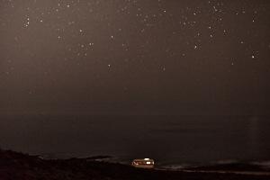 Fine art landscape photography of my van in front of the atlantic ocean in portugal