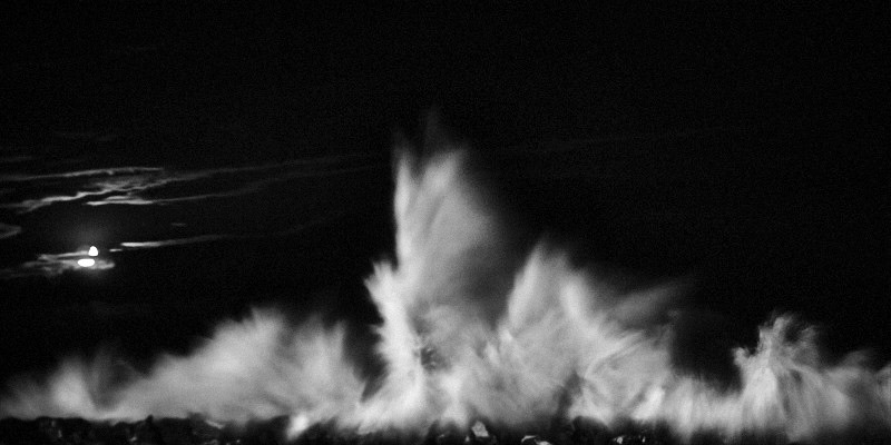 Black and white fine art photo of a nocturne seascapes of a wave