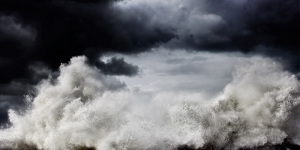 fine art photo of a stormy sea in Italy with a wave forming an abstract pattern with the clouds