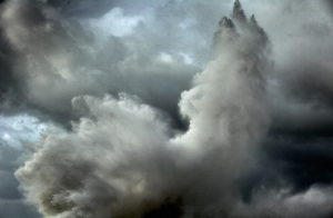 fine art photo of a stormy sea in Italy with a wave forming an abstract pattern with the clouds. Marina di Pisa