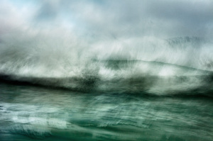 abstract fine art color image of a seascape. photo taken in the ocean of a wave breaking in front of me