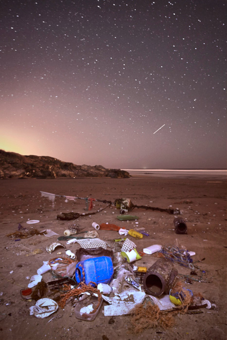 Seascape fine art photography of a beach in south portugal covered with plastic garbage