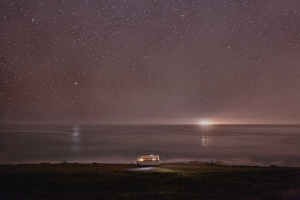 Fine art nightscape photographs of a motorhome traveling along the ocean