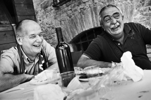 Fine art black and white photography of a Lunch in Contrada della Pantera before the horse race , Palio di Siena 2014