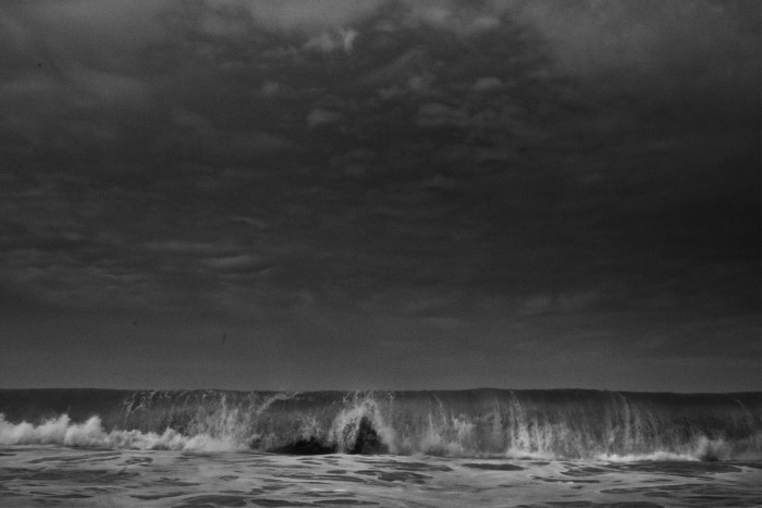 fine art black and white photograph of an abstract waves taken in th eater while doing some seascapes fine art photography