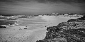 finer black and white photograph of a beach named Praia do Malhào in Portugal
