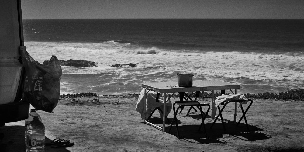 fine art seascape of the atlantic ocean with a picnic table in the foreground, image taken in Praia do Malhào