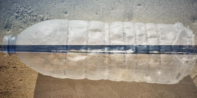 Fien art image of a plastic bottle wasted along a beach in Alentejo, Portugal
