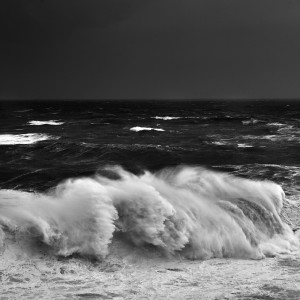 fine art black and white seascape of a big wave in Nazarè, Portugal