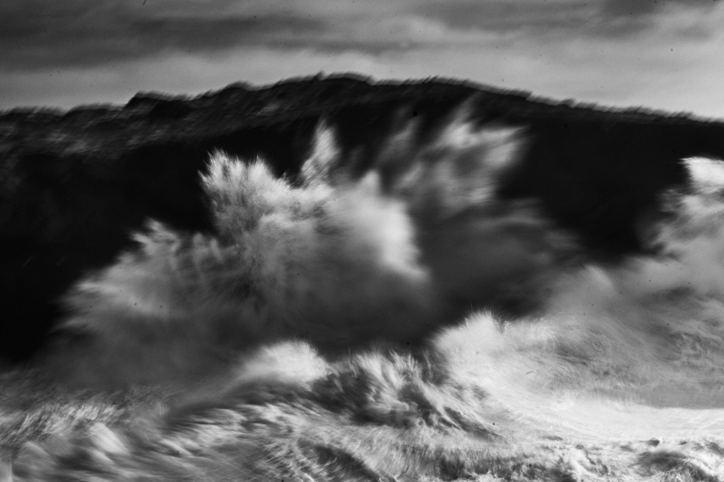 fine art abstract seascape of the Atlantic ocean breaking into a cliff in Portugal