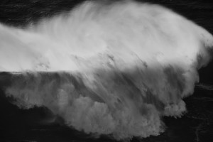 fine art black and white seascape of a huge wav e in Nazarè Portugal