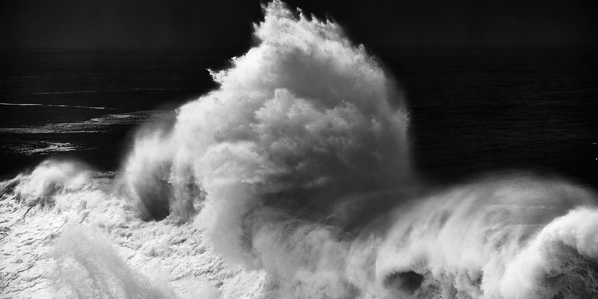 fine art black and white seascape of a huge wave from cyclone Ophelia hitting the Portuguese coast