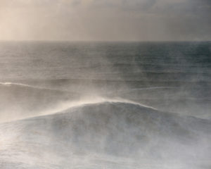 Sunset in the Atlantic sea in Nazaré during a big winter swell